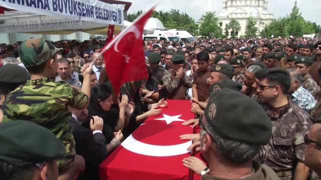 Relatives and family members along with hundreds of Turkish people attend a funeral ceremony for deputy head of Special Operations Department Meric...