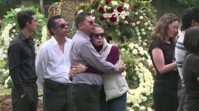 vídeos de stock, filmes e b-roll de relatives and friends on friday lay to rest gabriel morales and agueda mendoza a married couple found dead in each others arms and beside their dog... - embrace