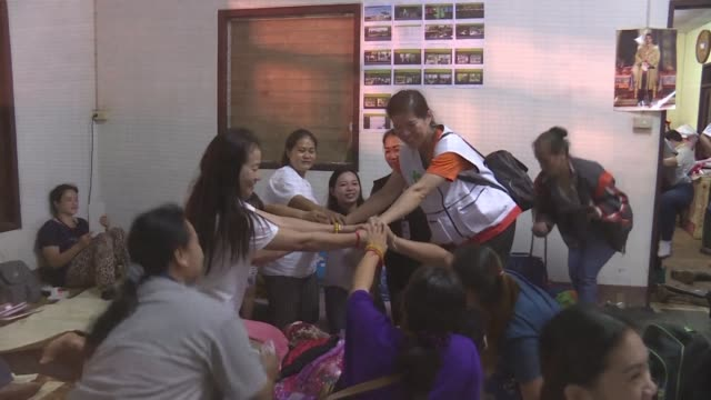 relatives gathered at a rescue camp in mae sai react after news that the 12 thai boys trapped in a flooded cave with their coach for nine days were... - thailand stock videos & royalty-free footage