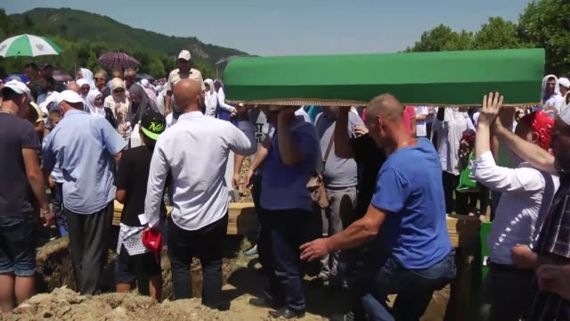 relatives mourn during the funeral ceremony of newly identified 71 srebrenica genocide victims to mark the 22nd anniversary of the srebrenica... - srebrenica stock videos and b-roll footage