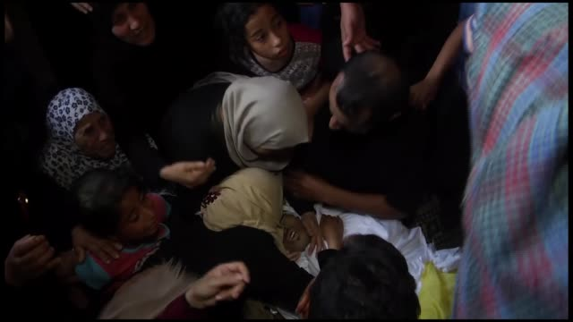 relatives mourn for 21-year-old palestinian mohammad isam abbas, martyred on friday by israeli army gunfire near the gaza-israel buffer zone, during... - historical palestine stock videos & royalty-free footage