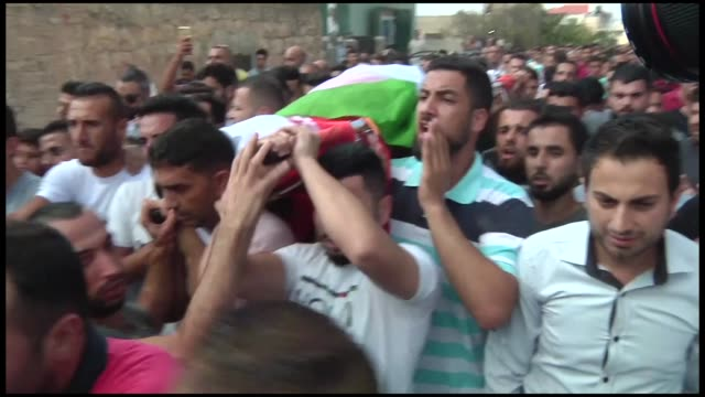 Relatives mourn for 45yearold Palestinian Aisha Muhammad Radi martyred late Friday when the vehicle she was traveling in was pelted with stones by...