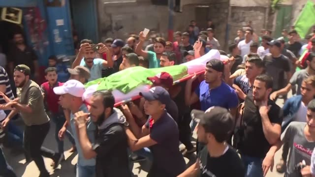 relatives of 14 year old khaled al-rabaee one of the two palestinian youths killed yesterday by israeli fire mourn his death as they participate in... - gaza city stock videos & royalty-free footage