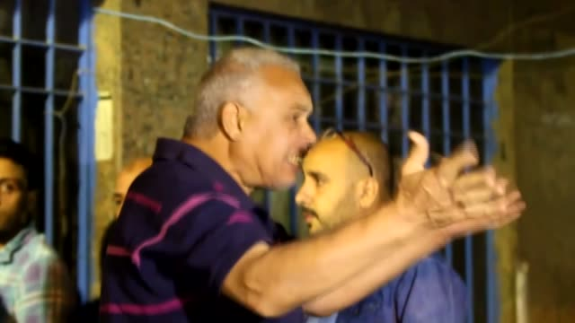 relatives of 9 members of the muslim brotherhood killed by egyptian security forces in a flat in the sixth of october area in cairo carry bodies of... - pompe funebri video stock e b–roll