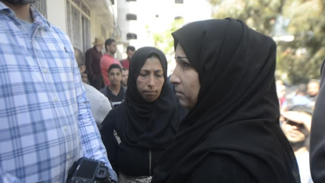 Relatives of a Palestinian baby of 8 months who according to the Palestinian health ministry died of tear gas inhalation during clashes in East Gaza...