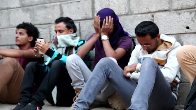 relatives of a photojournalist evab ezzebiri who was killed after the bomb exploded which had put into a disused building by houthis mourn in front... - photojournalist stock videos & royalty-free footage