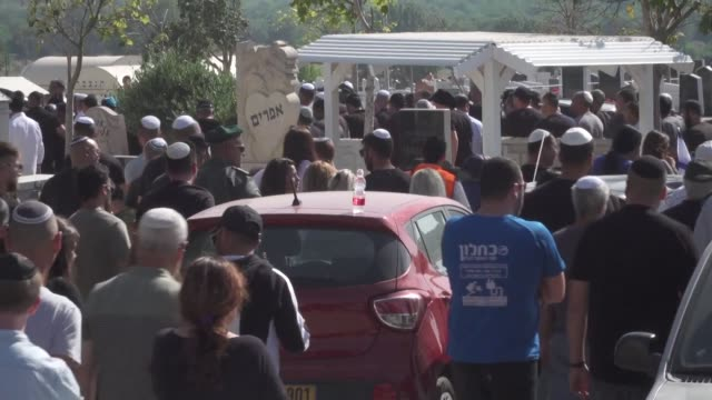 relatives of israeli moshe agadi mourn him during a funeral held at a cemetery in the southern israeli town of ashkelon near the gaza border - ashkelon stock videos and b-roll footage
