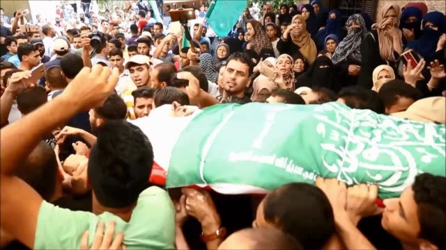 relatives of killed hamas member mohamed abu daqa mourn during his funeral in khan yunis in the southern gaza strip - hamas stock videos & royalty-free footage