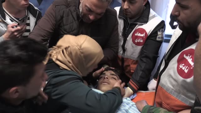 Relatives of Musab Firas EtTamimi killed after Israeli soldiers opened fire in Deir Nidham village mourn at a hospital in Ramallah West Bank on...