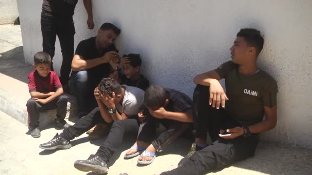 relatives of palestinian sabry ahmed abu khedr, mourn over his body after he was killed by israeli forces, on june 18, 2018 in gaza city, gaza. a... - historical palestine stock videos & royalty-free footage