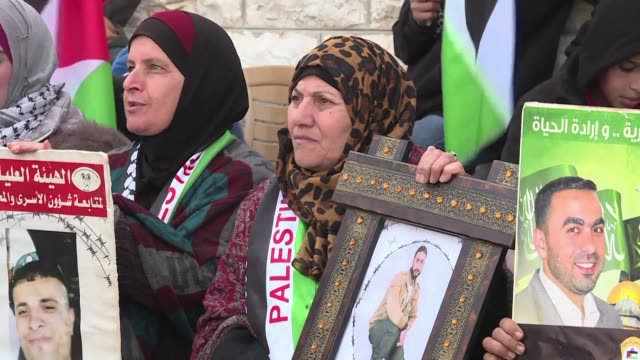 Relatives of Palestinians who are detained in Israel protested Tuesday in front of the Red Cross building in Ramallah