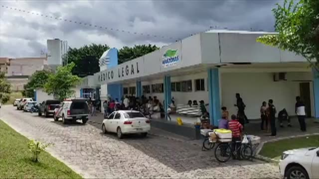 relatives of slain inmates await at the manaus morgue for the bodies of their loved ones - manaus stock videos and b-roll footage