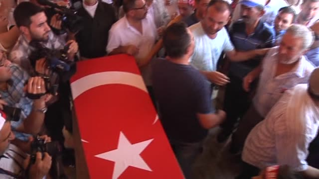 Relatives of soldier Ismail Yavuz who killed in a bomb attack to military vehicle in the southeastern province of Diyarbakir late Saturday mourn...
