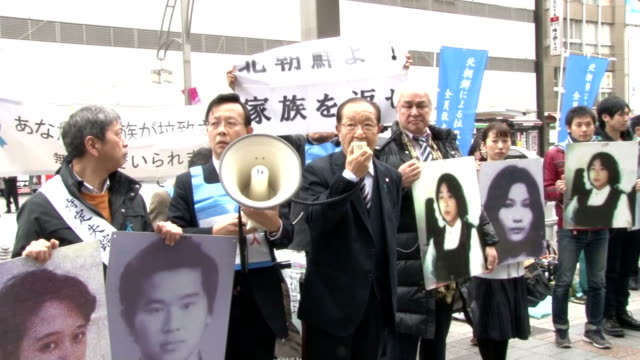 relatives of the japanese nationals abducted by north korea held a street demonstration near ueno park in tokyo on april 2, appealing to the cherry... - nationals park stock videos & royalty-free footage