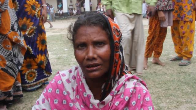 vídeos de stock, filmes e b-roll de relatives of victims killed in the collapse of rana plaza mourn on the savar adhar chandra high school ground near dhaka, bangladesh, friday. 25... - 2013