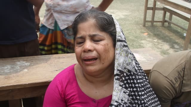 Relatives of victims killed in the collapse of Rana Plaza mourn on the Savar Adhar Chandra High School ground near Dhaka Bangladesh Friday 25 April...