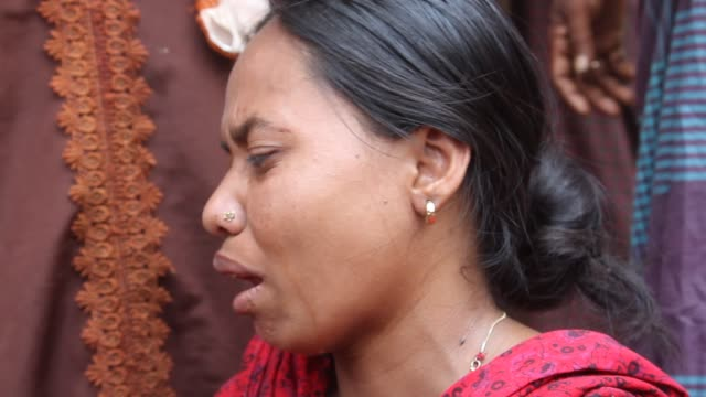relatives of victims killed in the collapse of rana plaza mourn on the savar adhar chandra high school ground near dhaka bangladesh friday 25 april... - 2013 stock videos & royalty-free footage