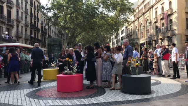 relatives of victims of barcelona and cambrils terror atacks lay a floral tribute at las ramblas on august 17, 2018 in barcelona, spain. the... - cambrils stock videos & royalty-free footage