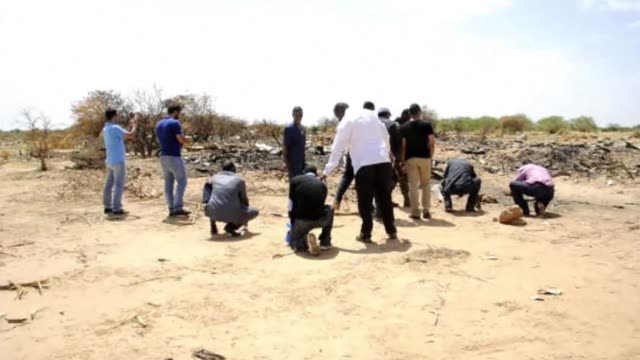 Relatives of victims of the Air Algerie plane crash in which all 118 people on board were killed visited the site Tuesday in Malis barren Gossi area...