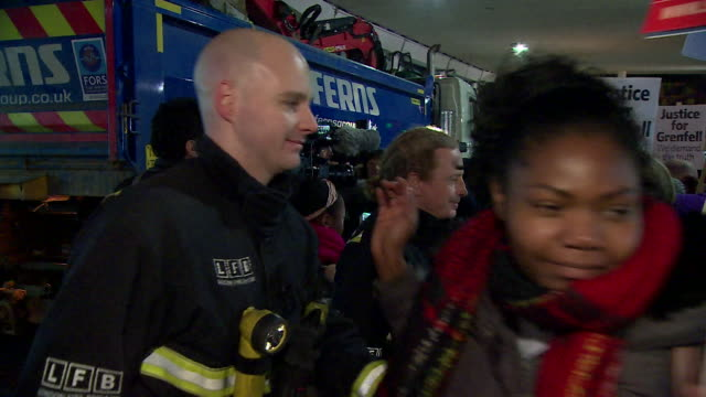 Relatives of victims of the Grenfell Tower disaster embracing firefighters six months on from the tragedy