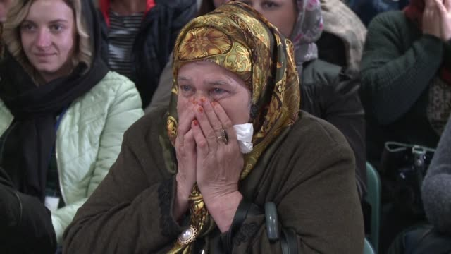 relatives of victims of the srebrenica massacre applaud the un court decision to hand a life sentence to bosnian serb wartime leader radovan karadzic... - sentencing stock videos & royalty-free footage