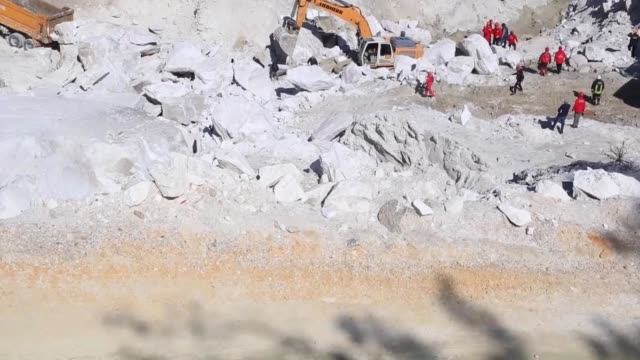 relatives of workers trapped in a feldspar openpit mining site following a landslide wait as search and rescue operations continue near the coastal... - mugla province stock videos and b-roll footage