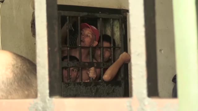 relatives visit venezuelan detainees at a police station's jail where 68 detaines died during an attempted jailbreak the day before when a blaze... - prison riot stock videos & royalty-free footage