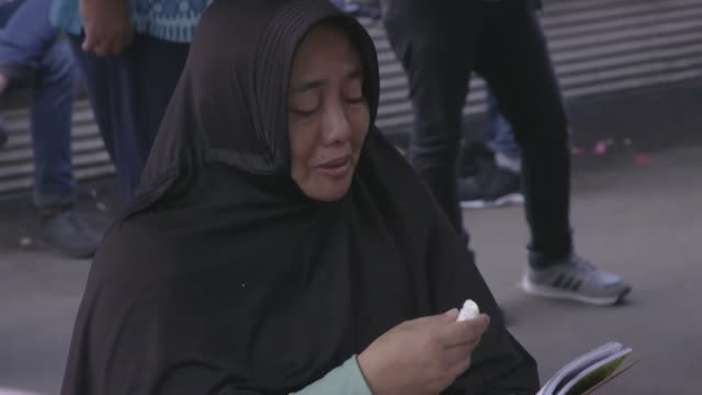 relatives wait for news of lovedones who were on board the lion air flight that has crashed october 2018 - boeing 737 stock-videos und b-roll-filmmaterial