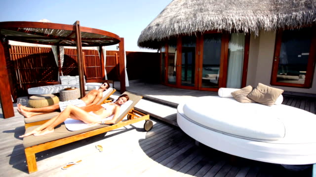 relax in ultimate luxury - deck chair stock videos & royalty-free footage