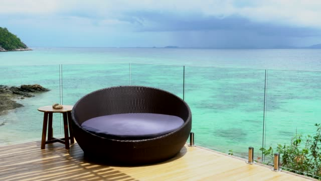 relax near the sea in the tropical - outdoor chair stock videos & royalty-free footage