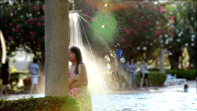 relaxation asia girl teen in out-door shower on swimming pool. - wet stock videos & royalty-free footage