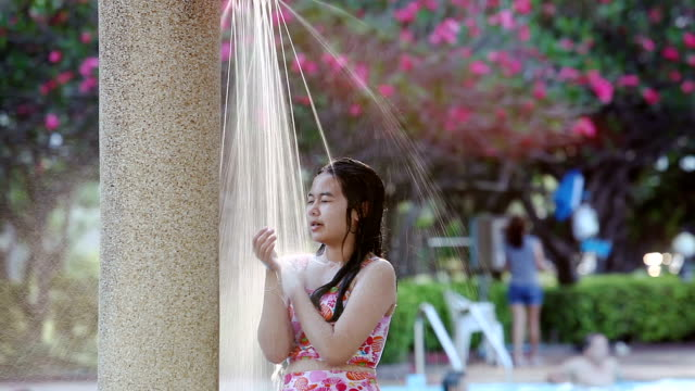 Relaxation Asia Girl Teen In Out Door Shower On Swimming Pool