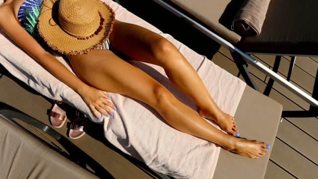relaxation at tropical swimming pool - sunbed stock videos & royalty-free footage