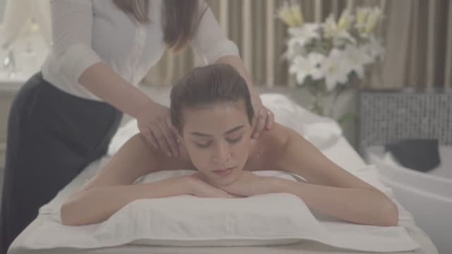 relaxation massage asian young woman - facial massage stock videos and b-roll footage
