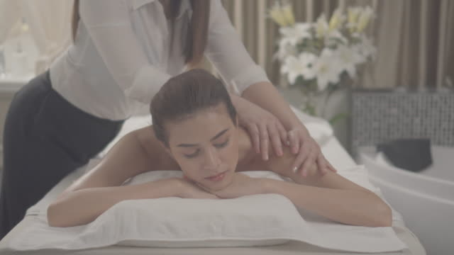 relaxation massage asian young woman - human face video stock e b–roll