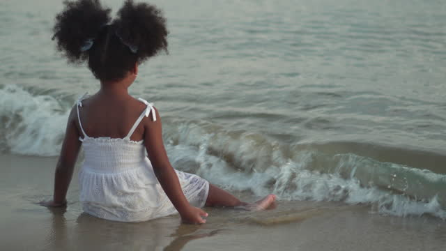 relaxation mood rear view african children on the beach - afro hairstyle stock videos & royalty-free footage