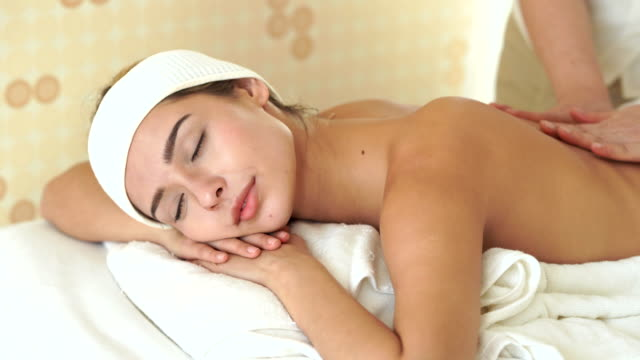 relaxation young women spa treatment on back massage  in spa center - massage stock videos & royalty-free footage