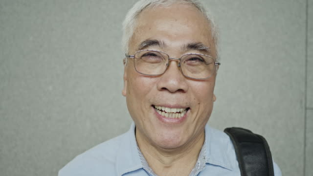 relaxed and smiling senior asian man - taipei stock videos & royalty-free footage