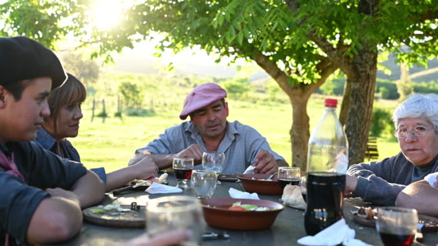 relaxed argentine gaucho family conversing at midday meal - argentinian culture stock videos & royalty-free footage