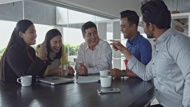 relaxed asian business people talking at office - malaysia stock videos & royalty-free footage
