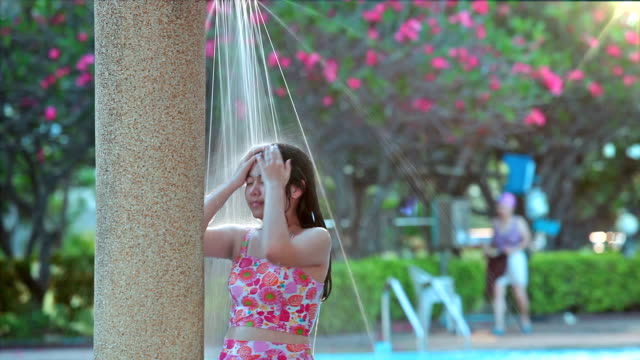 hd, relaxed asian girl teen in outdoor shower. - squirting woman stock videos and b-roll footage