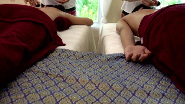 Relaxed couple having hot stone massage