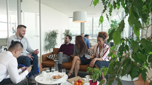 "relaxed group of business colleagues sitting in office lobby - xavierarnau or ""xavier arnau serrat"" stock videos & royalty-free footage"