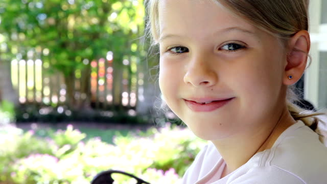 relaxed little girl looking closeup - one girl only stock videos & royalty-free footage
