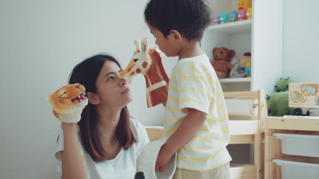 relaxed parenting. asian mother and son playing toys - puppet stock videos & royalty-free footage