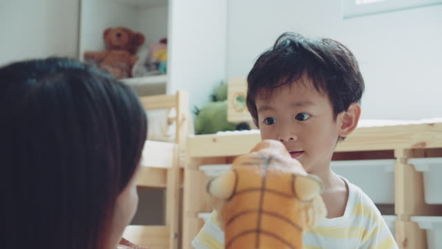 relaxed parenting. asian mother and son playing toys - game show stock videos & royalty-free footage