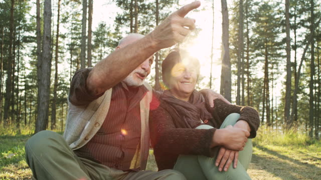Relaxed senior couple sitting outdoor