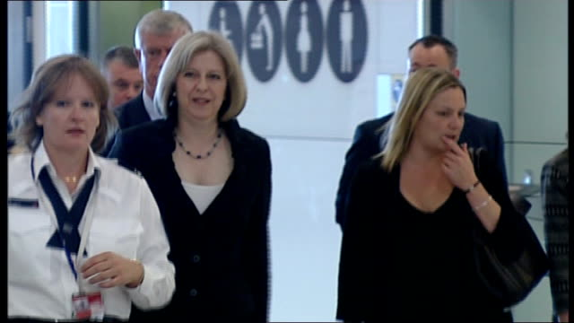 former border agency boss appears before select committee r14061001 / tx heathrow airport int theresa may mp along with brodie clark during visit to... - 登場点の映像素材/bロール