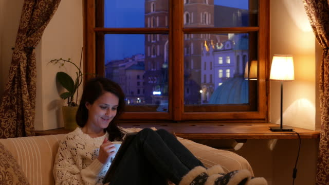relaxed woman at home using tablet pc - leg warmers stock videos & royalty-free footage