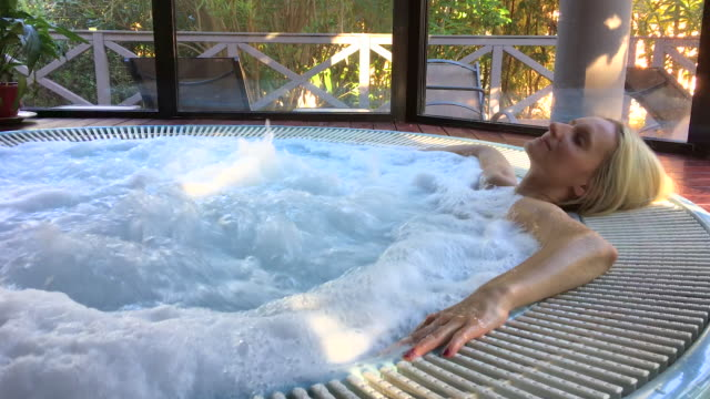 Relaxed woman in hot tub